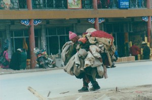 2001 China Aba street person trying to pick up one last thing
